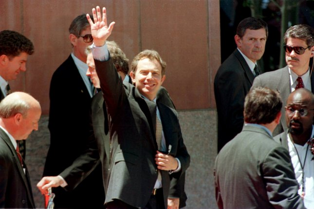 British Prime Minister Tony Blair waves as he departs the Denver Library on June 22, 1999, following the conclusion of the Denver Summit of the Eight. Photo by Jim Ruymen/UPI