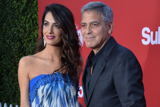 George Clooney (R) and Amal Clooney attend the Los Angeles premiere of Suburbicon on Sunday. Photo by Jim Ruymen/UPI