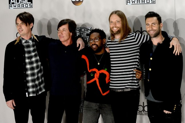 Mickey Madden, Matt Flynn, PJ Morton, James Valentine and Adam Levine (L-R) of Maroon 5 appeared to hint at a project with BTS this week. File Photo by Jim Ruymen/UPI