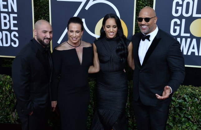 Left to right, Dave Rienzi, Dany Garcia, Simone Garcia Johnson and Dwayne Johnson attend the 75th annual Golden Globe Awards in Beverly Hills on January 7, 2018. File Photo by Jim Ruymen/UPI