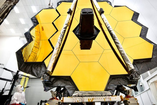 The towering primary mirror of NASA's James Webb Space Telescope stands inside a cleanroom in 2017 at NASA's Johnson Space Center in Houston. NASA Photo by Chris Gunn/UPI