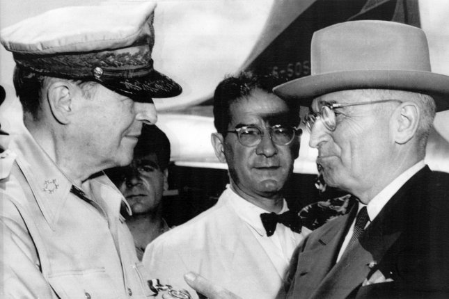 Gen. Douglas MacArthur (L) meets with President Harry S. Truman (R) on Wake Island on October 14, 1950, to discuss U.S. policy concerning South Korea. On April 11, 1951, Truman relieved MacArthur of his command in Korea. UPI File Photo