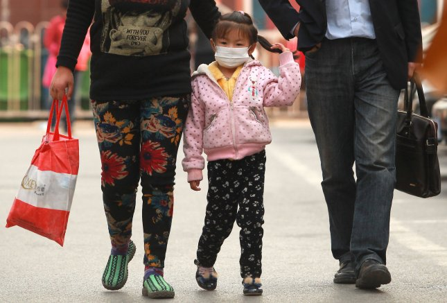 A third of bid flu cases fatal, and could return in the fall. Chinese leave a hospital protected by face masks as the spread of a new strain of bird flu dominates news headlines in Beijing on April 22, 2013. UPI/Stephen shaver