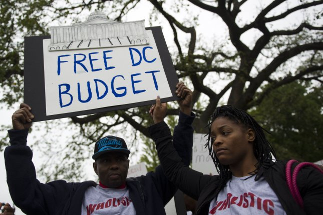 Protesters attend a rally on the D.C. budget and to end the government shutdown near the U.S. Capitol Building on October 9, 2013 in Washington, D.C. The government shutdown has entered its ninth day as the congress remains deadlocked over the budget. UPI/Kevin Dietsch