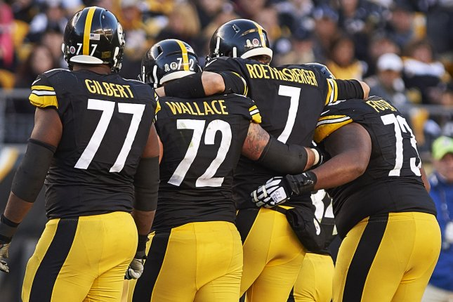 Pittsburgh Steelers quarterback Ben Roethlisberger (7) gets assistance from his teammates while leaving the field in the fourth quarter of the 38-35 Oakland Raiders loss at Heinz Field in Pittsburgh on November 8, 2015. Photo by Shelley Lipton/UPI