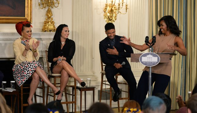 First lady Michelle Obama introduces the performers during her opening remarks at a student workshop honoring the music of Ray Charles in the State Dining Room of the White House on Wednesday. Demi Lovato was amongst the invited artists to the event. Photo by Pat Benic/UPI