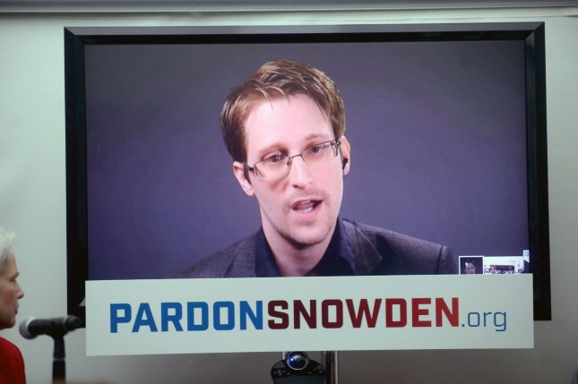 Edward Snowden speaks at a conference via a monitor Wednesday at the launch of a campaign calling on President Barack Obama to pardon him before he leaves office. The U.S. House Intelligence Committee released a report Thursday that concluded that Snowden was a disgruntled defense contractor who wasn't all that concerned with the privacy rights of American citizens -- a stark contrast from his public image. Photo by Dennis Van Tine/UPI
