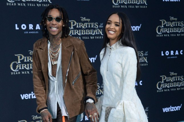 Wiz Khalifa and a guest attend the premiere of Pirates of the Caribbean: Dead Men Tell No Tales on May 18. Khalifa's music video for See You Again has become the most-viewed YouTube video of all time. File Photo by Jim Ruymen/UPI