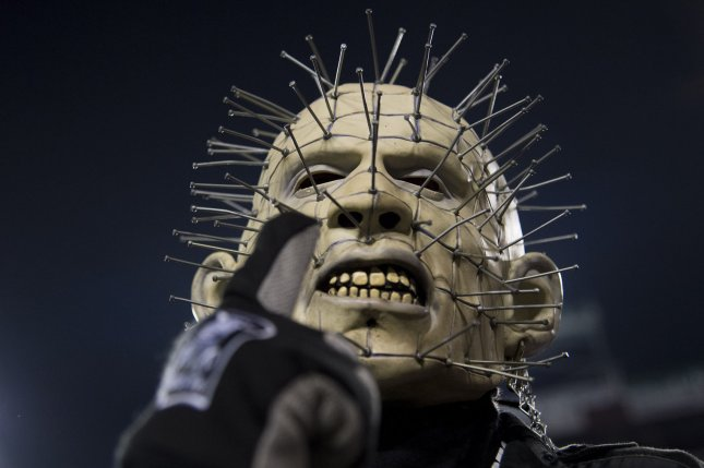 An Oakland Raiders fan cheers as the Raiders play the Washington Redskins on September 24 at FedEx Field in Landover, Md. Photo by Kevin Dietsch/UPI