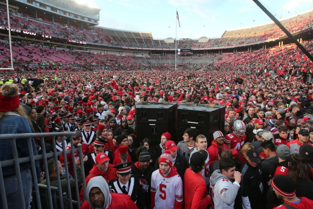 Ohio State fans fill the field after the Buckeyes crushed Michigan 62-39 on November 24 in Columbus, Ohio. Photo by Aaron Josefczyk/UPI