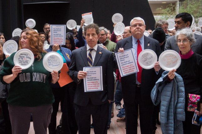 Rep. Jamie Raskin, D-Md., joins furloughed government workers and their supporters as they protest the federal government shutdown on Capitol Hill on Wednesday. The paper plates symbolize the struggle to feed their families without pay. Photo by Kevin Dietsch/UPI