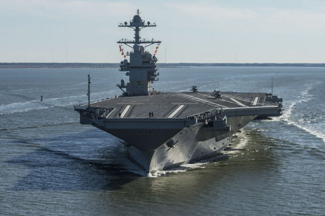 The future USS Gerald R. Ford sails on its own power for the first time out of Newport News, Va., in this April 2017 file photo. On Tuesday General Atomic received two contracts for work on the Electromagnetic Aircraft Launch System for the Ford ships. Photo by Ridge Leoni/U.S. Navy