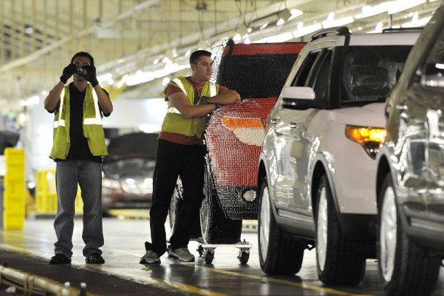 Workers assemble vehicles at a Ford plant in Chicago, Ill. Ford said Thursday multiple U.S. plants will reopen April 14. File Photo by Brian Kersey/UPI