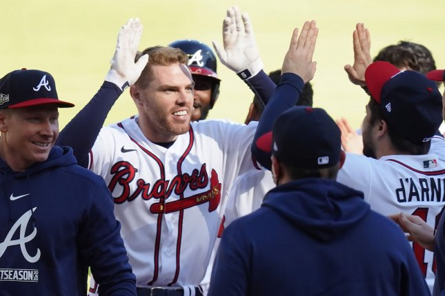 Atlanta Braves first baseman Freddie Freeman (C) celebrates with teammates after knocking in the winning run in the 13th inning against the Cincinnati Reds during their National League Wild Card Series game Wednesday at Truist Park in Atlanta. Photo by Tami Chappell/UPI