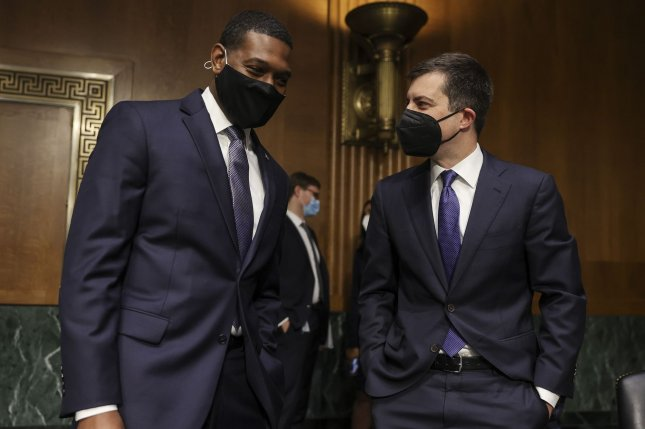 Transportation Secretary Pete Buttigieg (R) and Environmental Protection Agency Administrator Michael Regan talk before a Senate Appropriations Committee hearing in Washington D.C., on Tuesday. Photo by by Oliver Contreras/UPI
