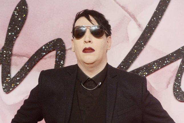 American singer Marilyn Manson, shown here at the Fashion Awards at Royal Albert Hall in London in December 2016, was sued this week by a former girlfriend alleging rape and sexual abuse in 2011. Photo by Rune Hellestad/ UPI