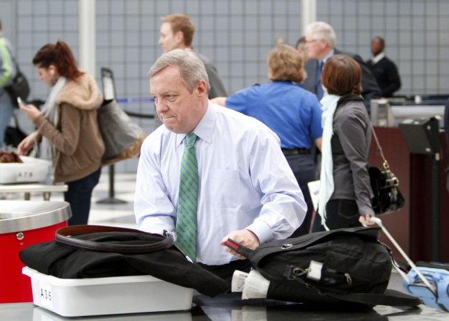 Sen. Dick Durbin (D-Ill.) passes through a security checkpoint at O'Hare International Airport in Chicago March 15, 2010. UPI/Brian Kersey