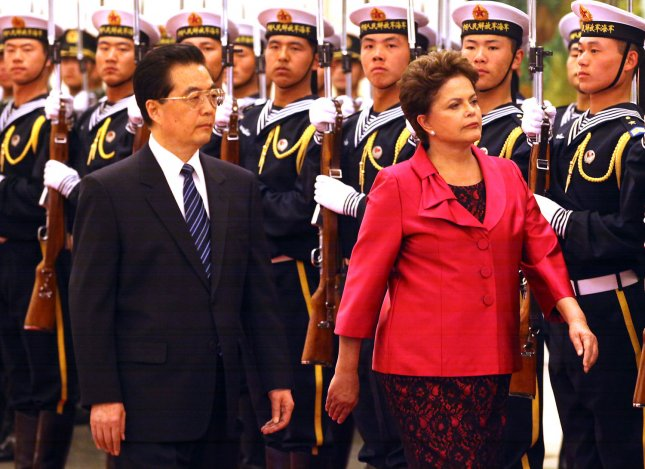 Brazil's President Dilma Rousseff (R) and China's President Hu Jintao inspect a military honor guard during a welcoming ceremony in the Great Hall of the People in Beijing on April 12, 2011. UPI/Stephen Shaver