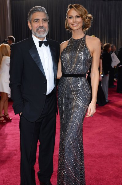 George Clooney and Stacy Keibler arrive on the red carpet at the 85th Academy Awards at the Hollywood and Highland Center in the Hollywood section of Los Angeles on February 24, 2013. UPI/Jim Ruymen