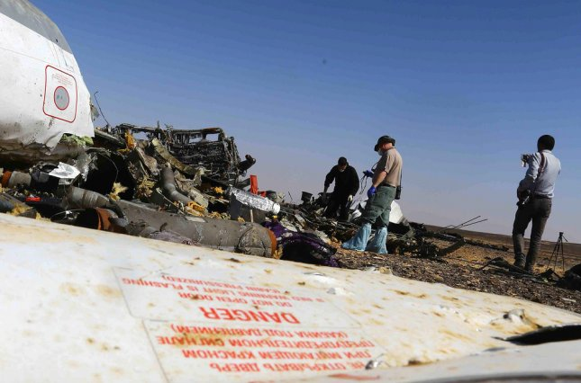 Russian investigators walk near wreckage of Metrojet Flight 9268 in Wadi el-Zolmat, a mountainous area in Egypt's Sinai Peninsula on November 1, 2015. The Russian plane was bound for St. Petersburg, Russia, carrying 224 passengers. Photo by Karem Ahmed/UPI
