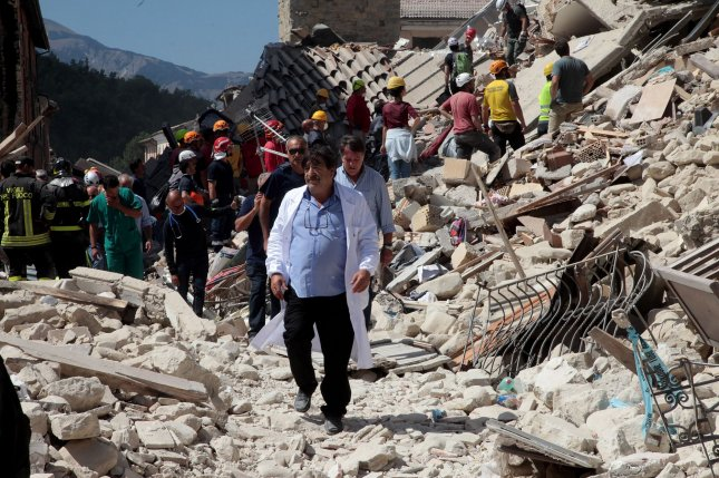 Rescuers search for victims wounded in Amatrice, Italy after a 6.2-magnitude earthquake struck the region on Wednesday. Photo by Marco D'Antonio/ UPI