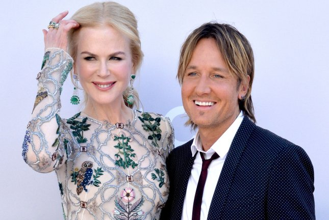 Nicole Kidman (L) and Keith Urban attend the 52nd annual Academy of Country Music Awards on April 2. Keith Urban took home multiple awards Wednesday during the CMT Awards that also featured winners Carrie Underwood, Little Big Town and Florida Georgia Line. File Photo by Jim Ruymen/UPI