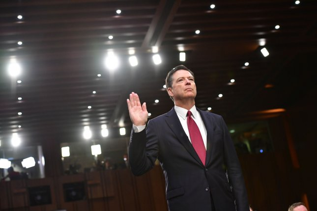 Former FBI Director James Comey is sworn in at a hearing of the Senate Select Committee on Intelligence on Thursday. Photo by Kevin Dietsch/UPI