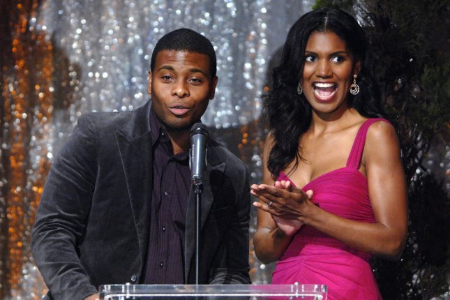 Kel Mitchell (L) and Denise Boutte present an award at the Diversity Awards on November 18, 2007. The actor and wife Asia Lee announced daughter Wisdom's birth this week. File Photo by Phil McCarten/UPI