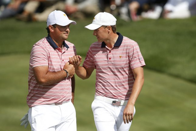 Patrick Reed, left, and Jordan Spieth of United States fist bump after completing play at the Presidents Cup on Friday. Photo by Rich Schultz/UPI
