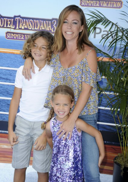 Kendra Wilkinson (R), pictured with son Hank and daughter Alijah, gave an update on her split from Hank Baskett. File Photo by Patrick Rideaux/UPI