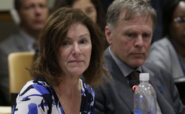 Cindy Warmbier and Fred Warmbier listen to speakers at a meeting on the Human Rights Situation in the DPRK on May 3, 2018. A federal judge in Washington D.C., ordered North Korea to pay the couple $500 million for the wrongful death of their son, Otto Warmbier, who was detained for 17 months. Photo by John Angelillo/UPI