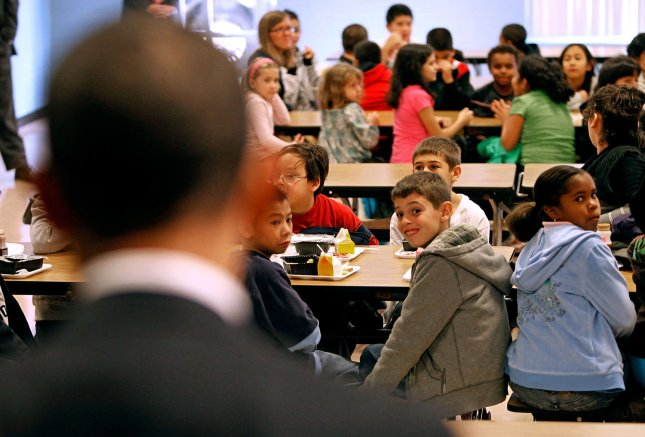Third and fourth graders watch as U.S. President Barack Obama speaks to them during their lunch period at Viers Mill Elementary School October 19, 2009 in Silver Spring, Maryland. The elementary school was selected as a 2005 National No Child Left Behind Blue Ribbon school. UPI/Chip Somodevilla/Pool