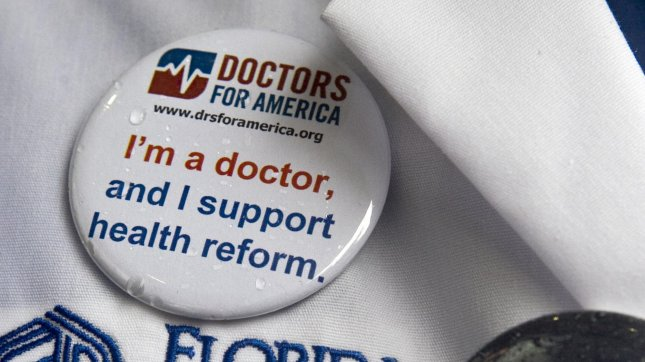 Members of Doctors for America wear buttons during a march through downtown Washington, DC to a press conference to show their support for the health care reform bill in Washington March 22, 2010. UPI/Madeline Marshall