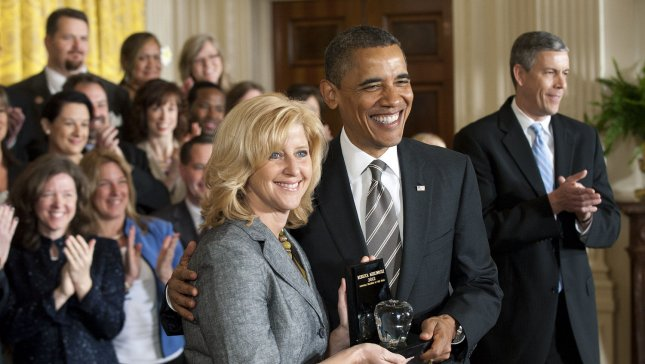 President Obama awards the 2012 Teacher of the Year award to Rebecca Mieliwocki, a seventh-grade teacher at Luther Burbank Middle School, in Burbank, California, as Education Secretary Arne Duncan and Teacher of the Year finalist applaud, during a ceremony in the East Room at the White House in Washington, D.C. on April 24, 2012. UPI/Kevin Dietsch