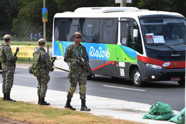 Armed soldiers stand guard at the entrance to the Athletes Village in Rio de Janeiro on Friday. Amnesty International has reported that police killings in Rio have increased by 103 percent. The opening ceremony for the Olympic Games is scheduled for Friday. Photo by Terry Schmitt/UPI