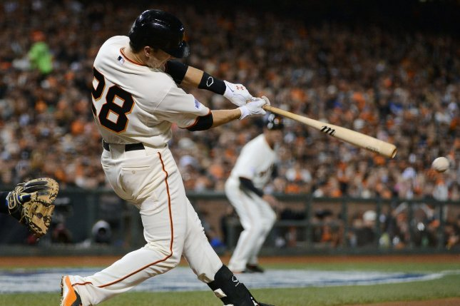 San Francisco Giants catcher Buster Posey gets a hit. File photo by Terry Schmitt/UPI