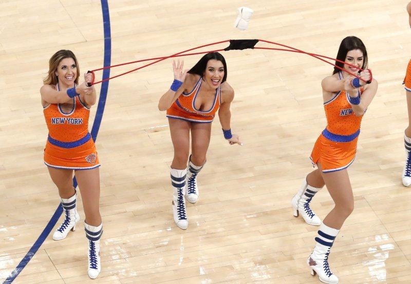 New York Knicks cheerleaders shoot t-shirts into the crowd during a game last season. Photo by John Angelillo/UPI
