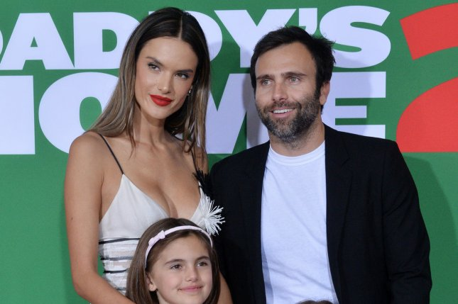 Alessandra Ambrosio (L), pictured with Jamie Mazur and their kids, stepped out with friends Saturday after reportedly calling it quits with Mazur. File Photo by Jim Ruymen/UPI