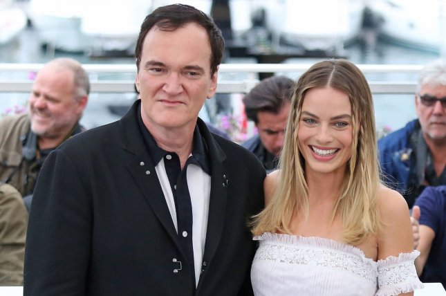 Margot Robbie (R), pictured with Quentin Tarantino, discussed Once Upon a Time in Hollywood and Tarantino in the July issue of Vogue. File Photo by David Silpa/UPI