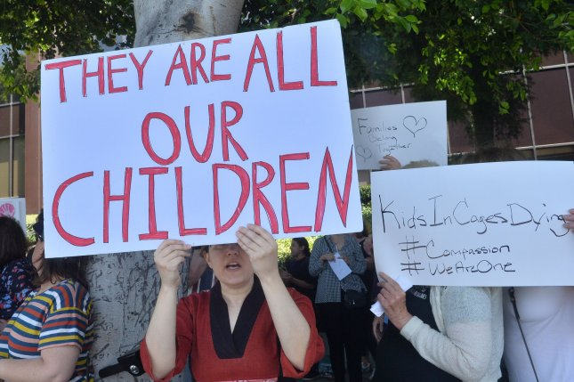 Activists in Los Angeles join demonstrators across the country Tuesday demanding the closing of detention centers for migrant children and their families. Photo by Jim Ruymen/UPI