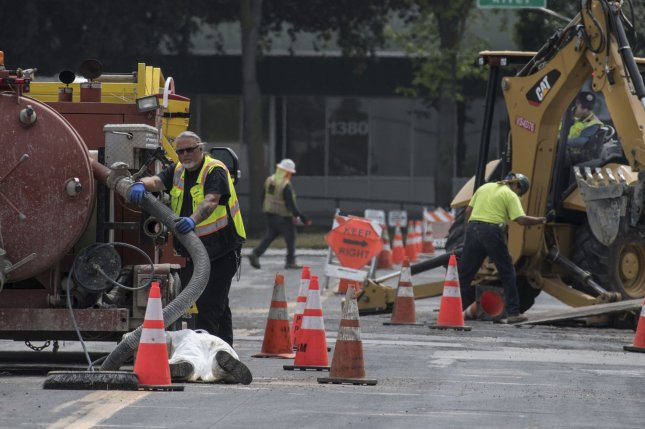 Construction workers are seen working on a project in Sunnyvale, Calif., on April 16, 2020. Monday's report says shortened life spans related to long work hours significantly affected men and those who live in the Western Pacific and Southeast Asia. File Photo by Terry Schmitt/UPI