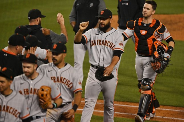 The San Francisco Giants celebrate on May 28 after defeating the Los Angeles Dodgers 8-5 at Dodger Stadium in Los Angeles. Photo by Jim Ruymen/UPI