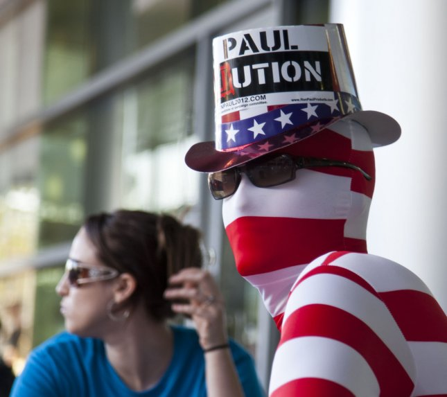 Ron Paul supporter, Joseph Upthegrove (R) takes a break while his friend, Kelly Williams, eats a salad at the University of North Florida in Jacksonville, Florida on January 25, 2012. The pair were walking the campus prior to the final GOP debate before the Florida primary