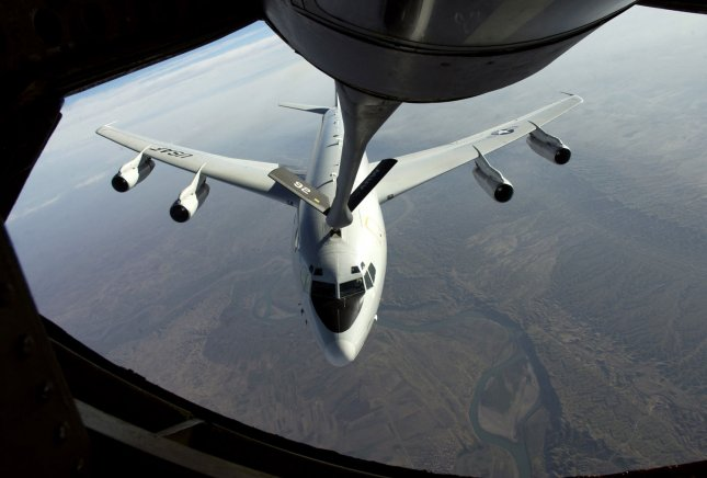A E-8C Joint Surveillance Target Attack Radar System (Joint STARS), piloted by Major Chris Wright and Captain Todd Avery of the 12th Expeditionary Airborne Command Control Squadron, receives fuel from a KC-135 over Iraq on Jan. 2, 2004. The E-8C is a long-range, air-to-ground surveillance system designed to locate, classify and track ground targets in all weather conditions. (UPI Photo/Suzanne Jenkins/Air Force)