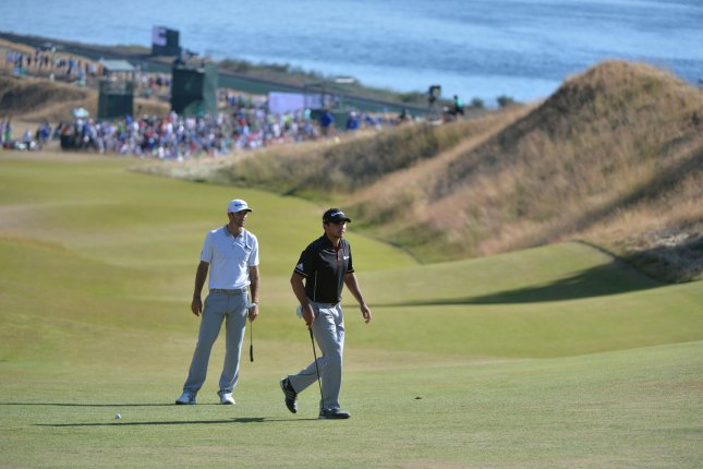 Dustin Johnson (L) and Jason Day walk at the 115th U.S. Open Championship on June 21, 2015 in University Place, Washington. Johnson and Day are the favorite picks to the 2016 RBC Canadian Open which starts tomorrow. Photo by Kevin Dietsch/UPI