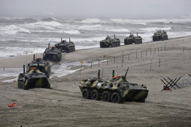 Russian marines take part in the landing operation during the strategic military exercises at the Khmelevka training range in the Kaliningrad region on the Baltic Sea in 2009. More recently, in October 2016, Russian forces deployed nuclear missiles as part of a military exercise. Photo by UPI/Anatoli Zhdanov