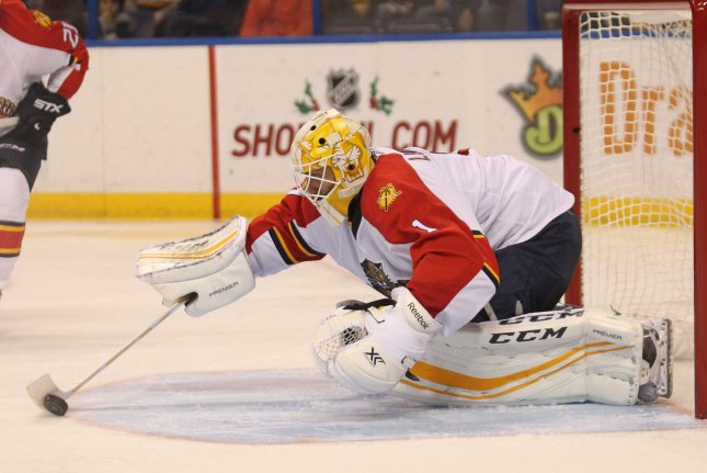 Florida Panthers goaltender Roberto Luongo scoops up the loose puck in front of the net in the third period against the St. Louis Blues at the Scottrade Center in St. Louis on December 1, 2015. Florida defeated St. Louis 4-1. Photo by Bill Greenblatt/UPI