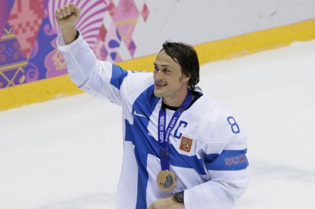 Finland's Teemu Selanne (8) acknowledges the crowd with his bronze medal after defeating USA in the bronze medal game at the Sochi 2014 Winter Olympics on February 22, 2014 in Sochi, Russia. Finland defeated USA 5-0 for the bronze medal. File photo by Molly Riley/UPI