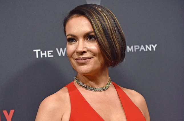 Alyssa Milano took to Twitter after many accused her Netflix series of promoting fat-shaming. File Photo by Christine Chew/UPI