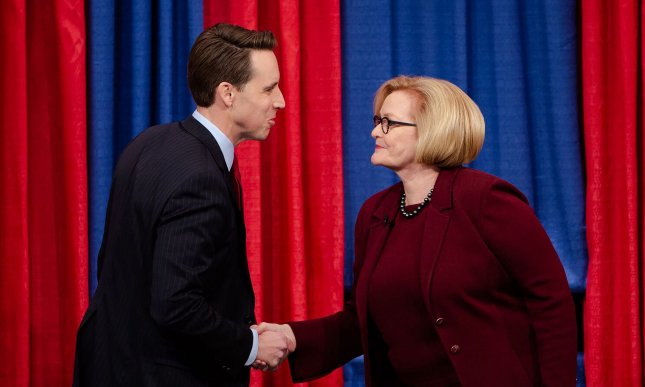 Missouri Sen. Claire McCaskill (R) and Missouri Attorney General Josh Hawley shake hands before the start of their debate in St. Louis on October 18. Pool Photo by St. Louis Public Radio/UPI